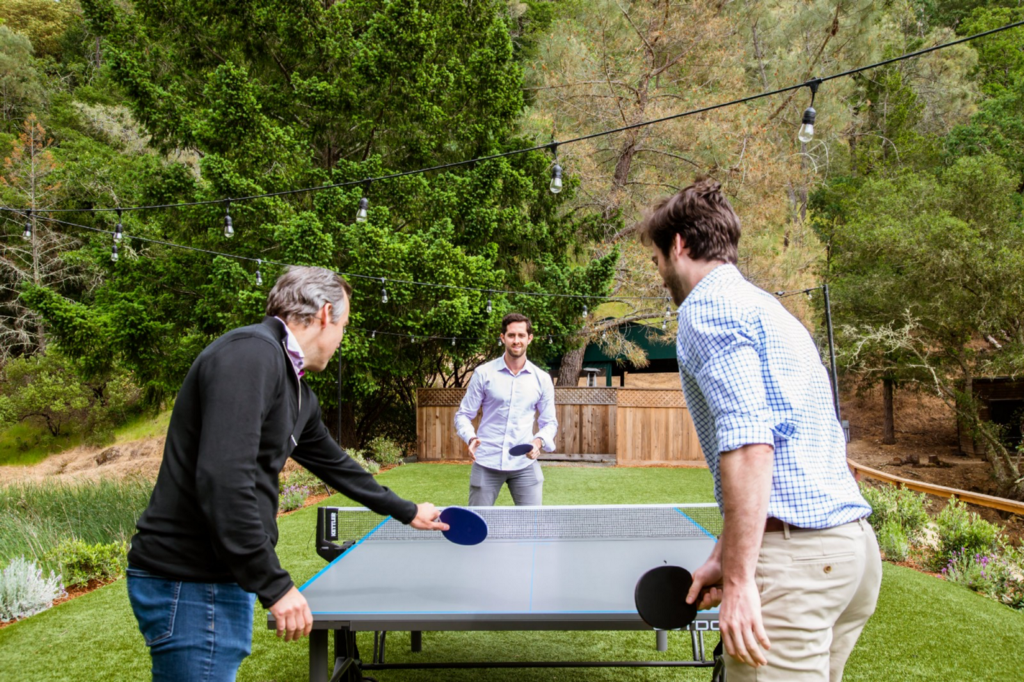 Adam Spivack and co playing ping pong