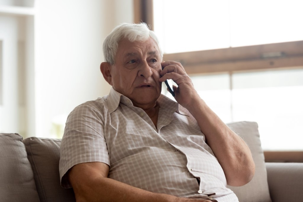 Old mane making a phone call to his general practitioner