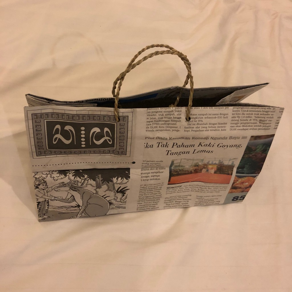 Handmade carry bag made from newspaper and twine