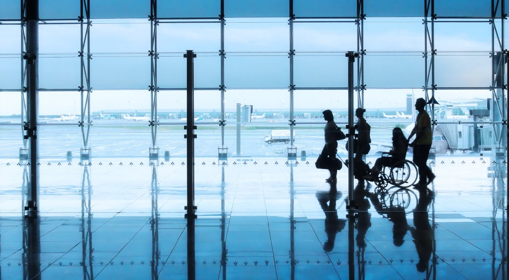Airport travelers in a terminal.