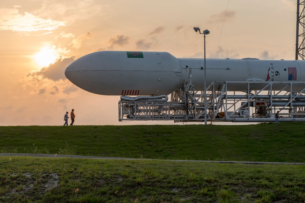 Rolling out a Space X Falcon 9 launch vehicle.