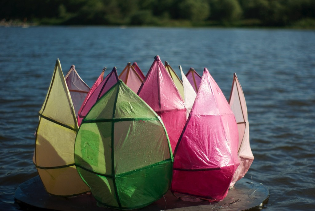 Plastic flower sculpture in a lake.