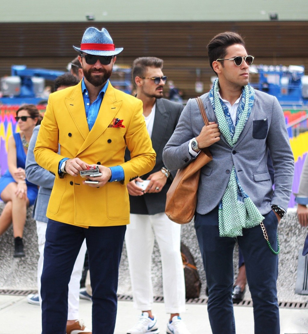 Two males, mid-20s dressed like hipsters.