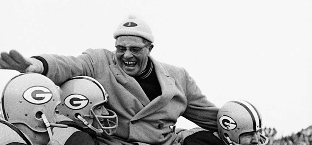 Green Bay Packers head coach Vince Lombardi gets carried off of the field by his players after winning the 1961 NFL Championship game versus the New York Giants at City Stadium.  Green Bay, Wisconsin 12/31/1961 (Image # 2053 )
