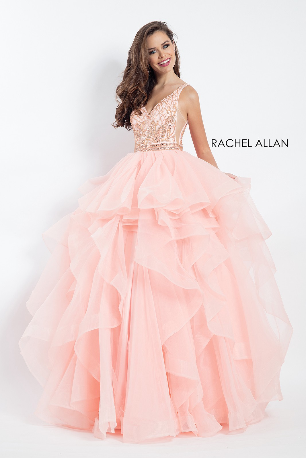 Look modish and awe-inspiring in ruffled blush color Prom Gowns