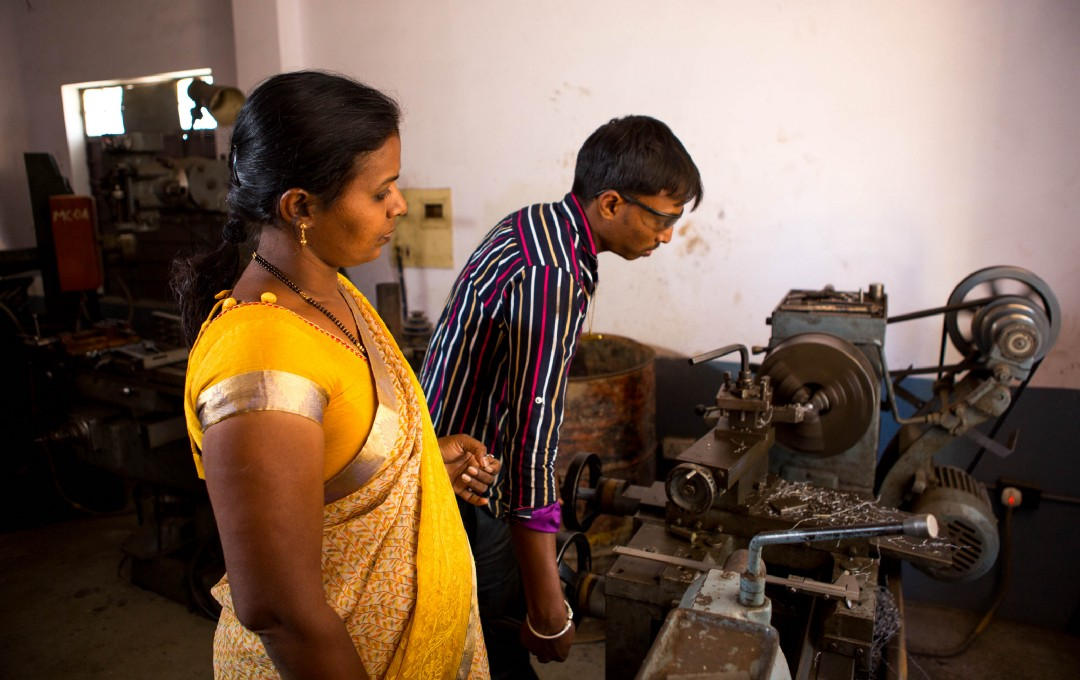 Vanaja inspects one of the machines she bought using a small business loan from Aye Finance