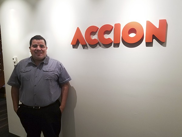 Jose in front of Accion's sign