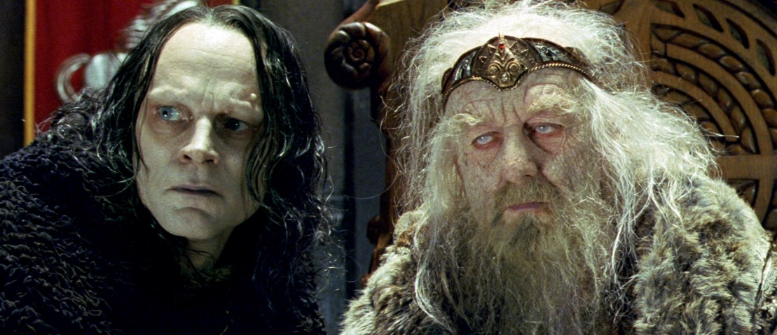 Grima Wormtongue sitting next to a magically aged Théoden (King of Rohan) as he sits in his throne.
