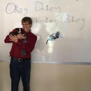 Standing with Okey Dokey in front of my whiteboard.