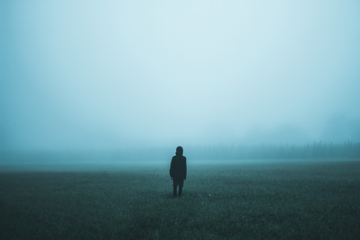 person alone in the fog