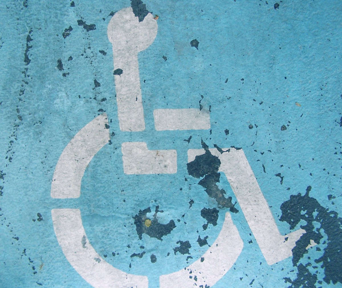 How every issue is a disability justice issue marion medium image description the international symbol of access appears in cracked and fading paint freeimages biocorpaavc