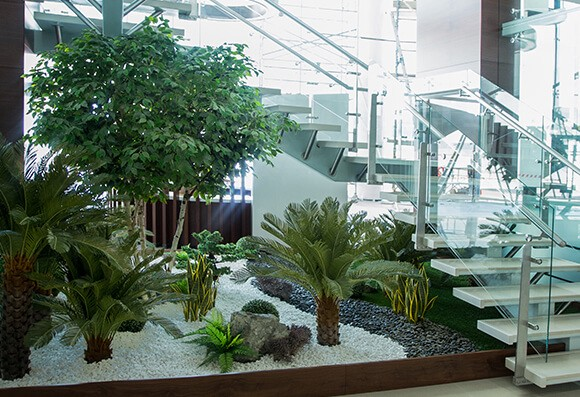 The Best Indoor Landscaping Ideas For Your Office Using Artificial Plants