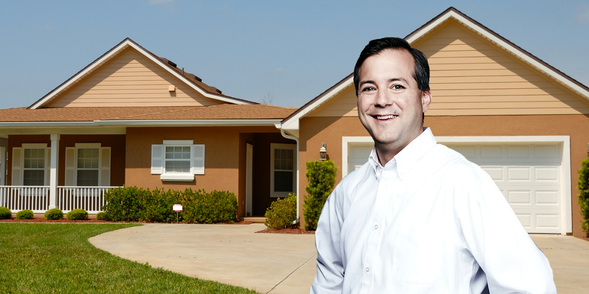 A man happily looks onward before his single family house.