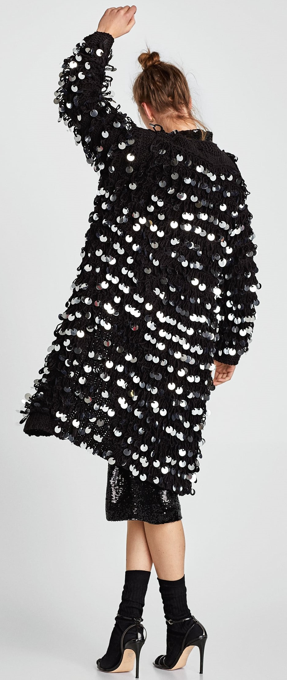 57f73384 Black Faux Leather Dress with Eyelets, $69.90 and Black Sequinned Coat,  $119: I would style this leather dress totally differently, but the dress  itself is ...