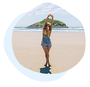 Woman with long hair stretching on sandy beach