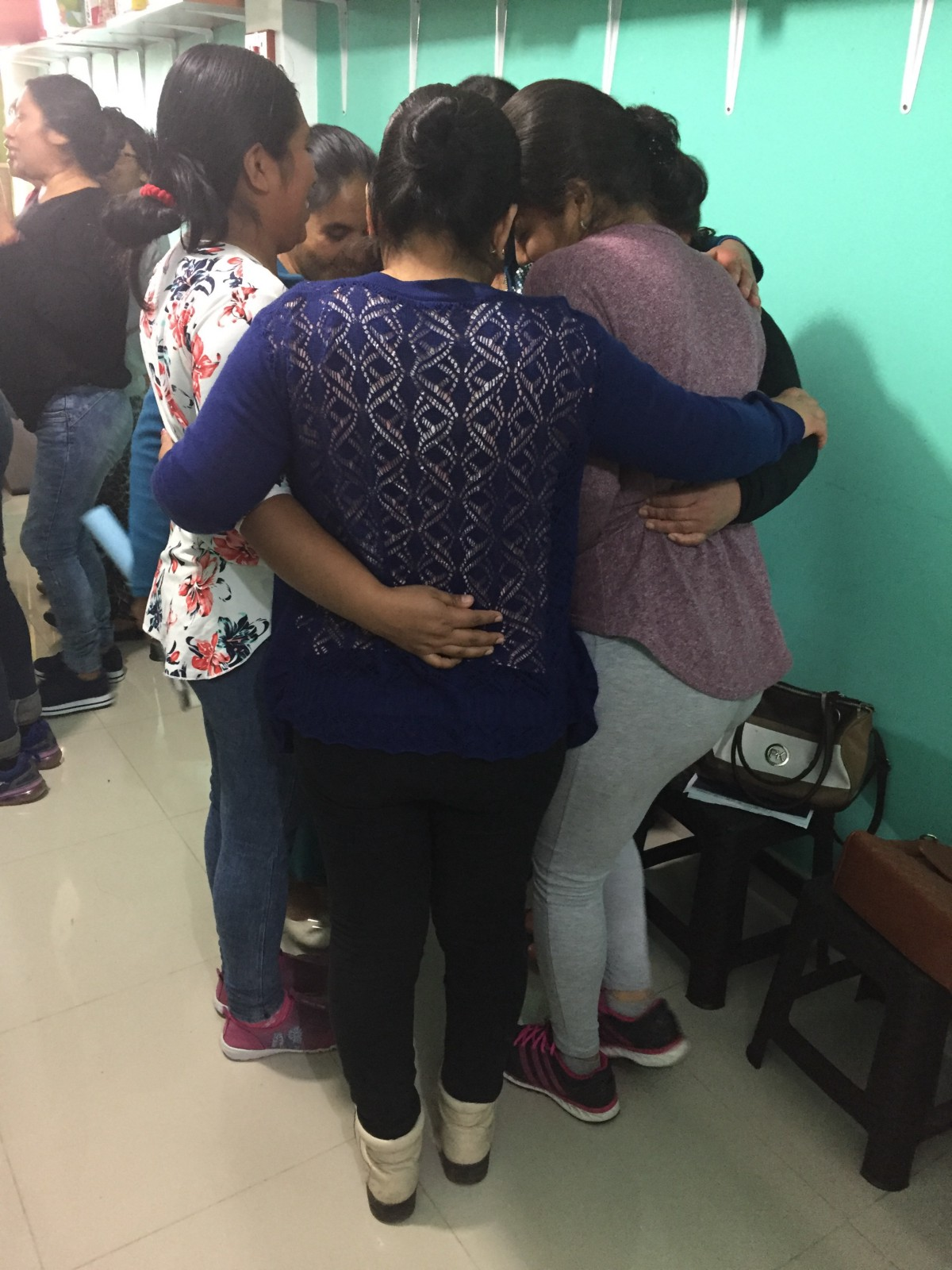 Mothers from rehabilitation with hope support one another.