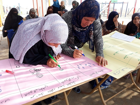 A Syrian student and her mother engage in an activity aimed at teaching parents coping skills to help their children recover from the trauma of war. (Photos courtesy of Chemonics International)