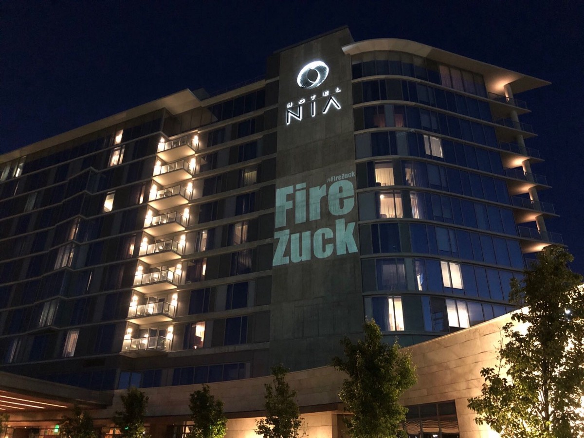 "We projected ""Fire Zuckerberg"" onto the side of the Facebook shareholders meeting last night"