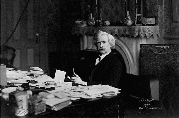 Mark Twain at his desk