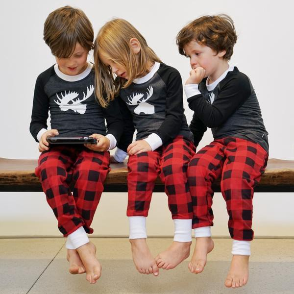 914ae119d9 ... buy matching Family Christmas Pajamas for the whole family. There can t  be a better way to absolutely delight your kids when they see mommy and  daddy ...