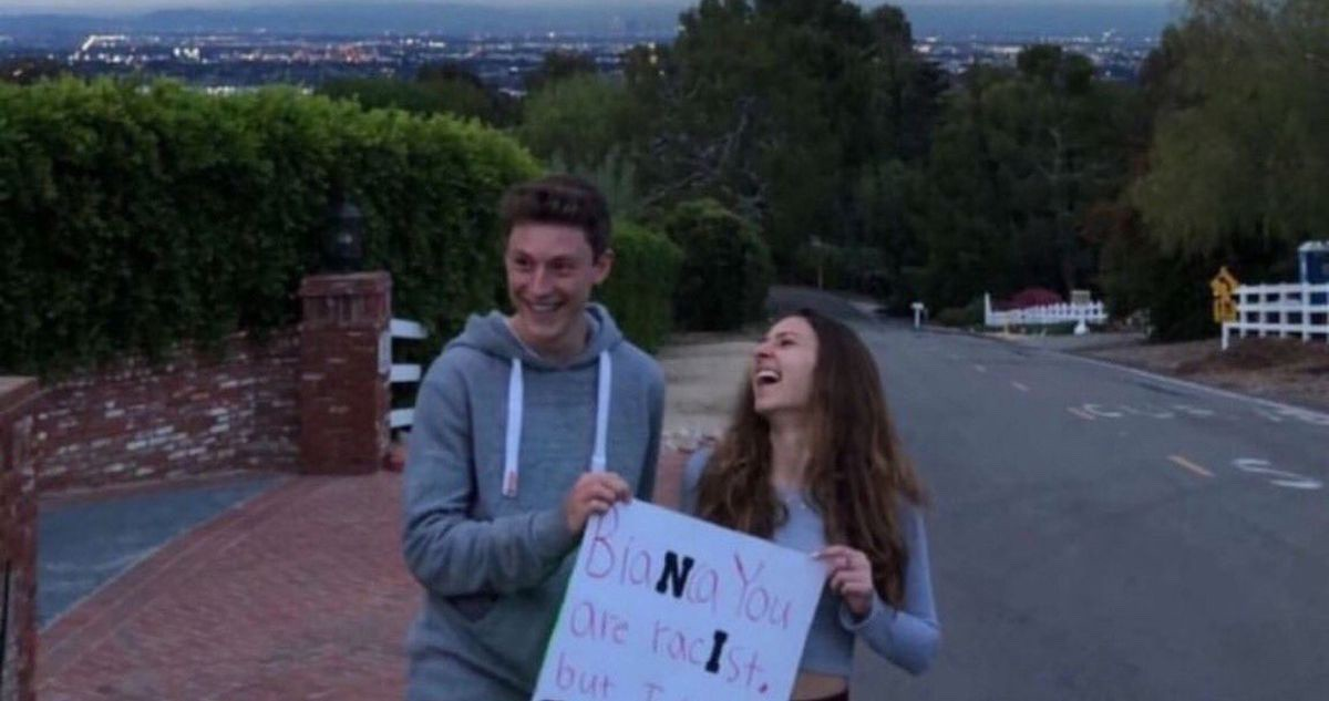 "fa0cbc0e609 Two students at a Southern California high school will face ""severe  consequences"" after a photo of them holding up a racist ""promposal"" sign  sparked outrage ..."