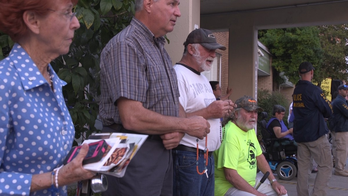 Insults and beliefs exchanged as Louisville abortion protest meets counter-protest