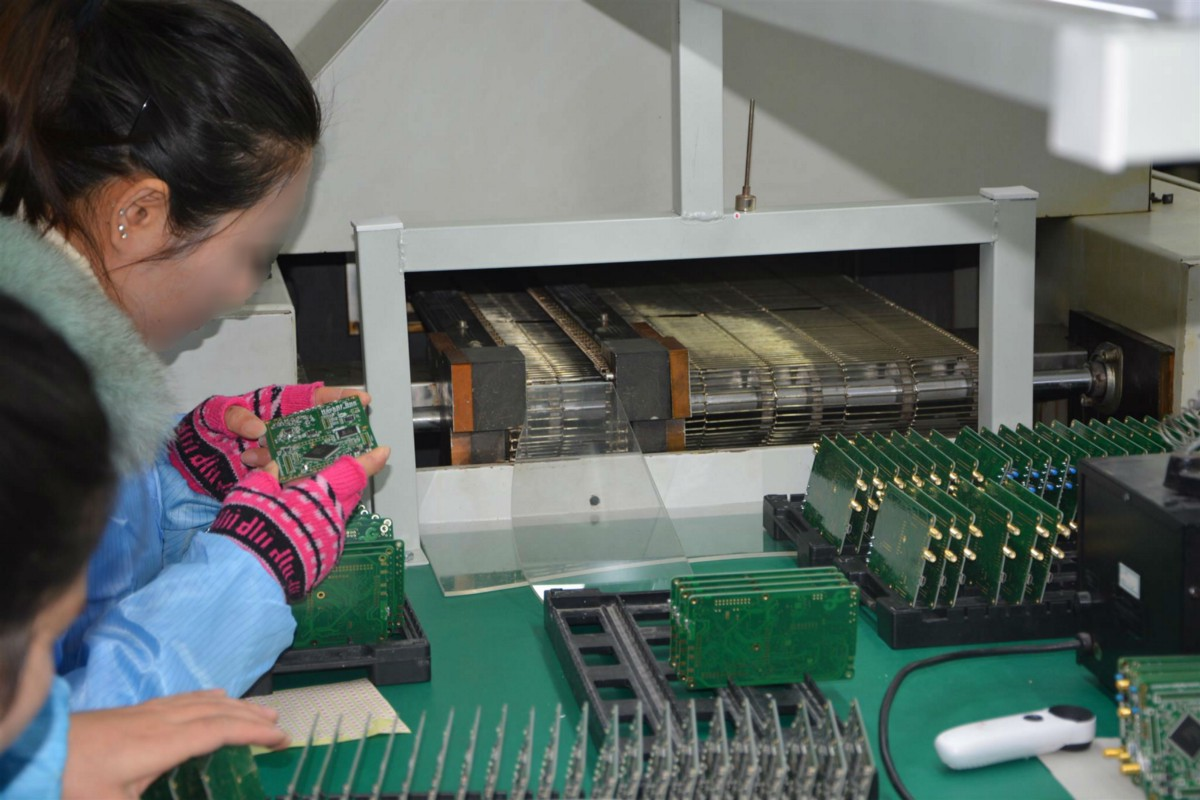 Shanghais Contract Manufacturing A Factory Visit Pcb Assembly Manufacture Electronic Circuit Board China Buy This Is New Facility Shiny Machines On The Left Pick And Place Reflow Ovens Etc Manual Quality Inspection Of Boards