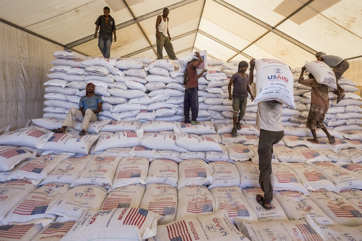Workers in Ethiopia offload a USAID food donation. The Agency is in the forefront of helping the United States respond to, counter and prevent complex threats and crises around the globe. / Petterik Wiggers, WFP