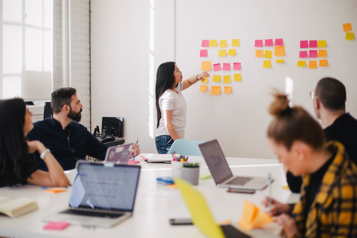 Top 10 Things I Wish I Could Do at Work, #7: Placing a sticky note on the wall as I make a point during discussion with my colleagues [You X Ventures on Unsplash]