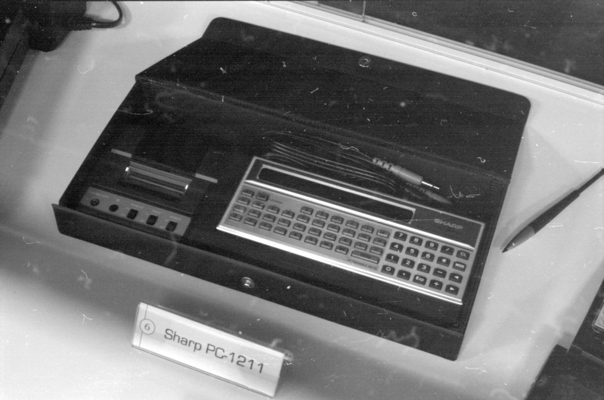 Sharp's 1980 PC-1211, in its travel case (which also had space for a printer). This machine, rebadged as the TRS-80 by Radioshack, is the same as the one Isaac Asimov is holding at the top of this article. (Photo credit: Rama/CC BY-SA 2.0).