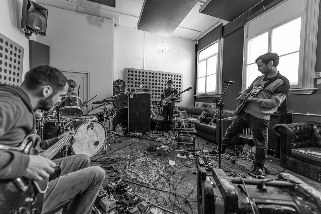 Some band practicing in a room