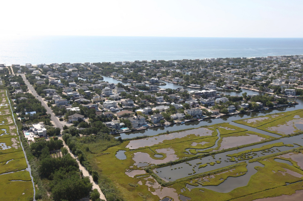 aerial view of buildings and shoreline