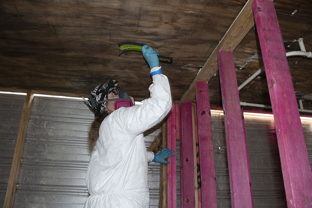 SBP Deployment Team member remediates mold in a home in Vinton, LA.