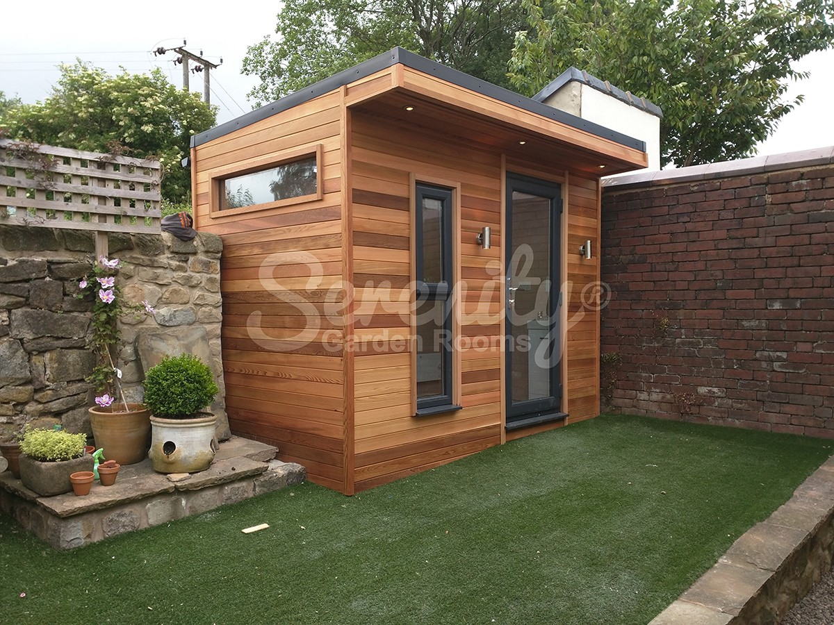 Cosy garden room with horizontal red cedar cladding. Great for all ...