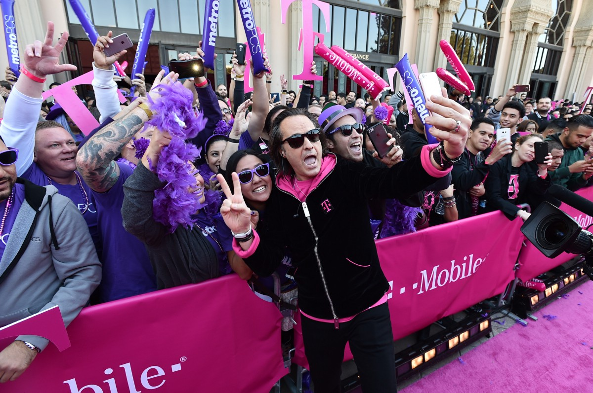 "T-Mobile CEO John Legere mingles with T-Mobile and Metro PCS employees outside of Shrine Auditorium before the Uncarrier X event on Wednesday, where the company announced ""Binge On,"" among other things. Photo courtesy of T-Mobile."
