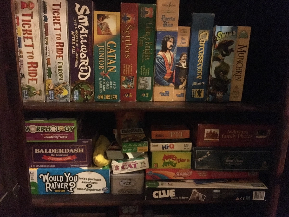 My Recently Organized Game Cabinet, Which No Longer Looks Anywhere Near  This Neat