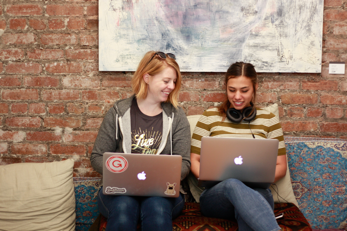 Two of our hackers collaborating at our San Francisco location.