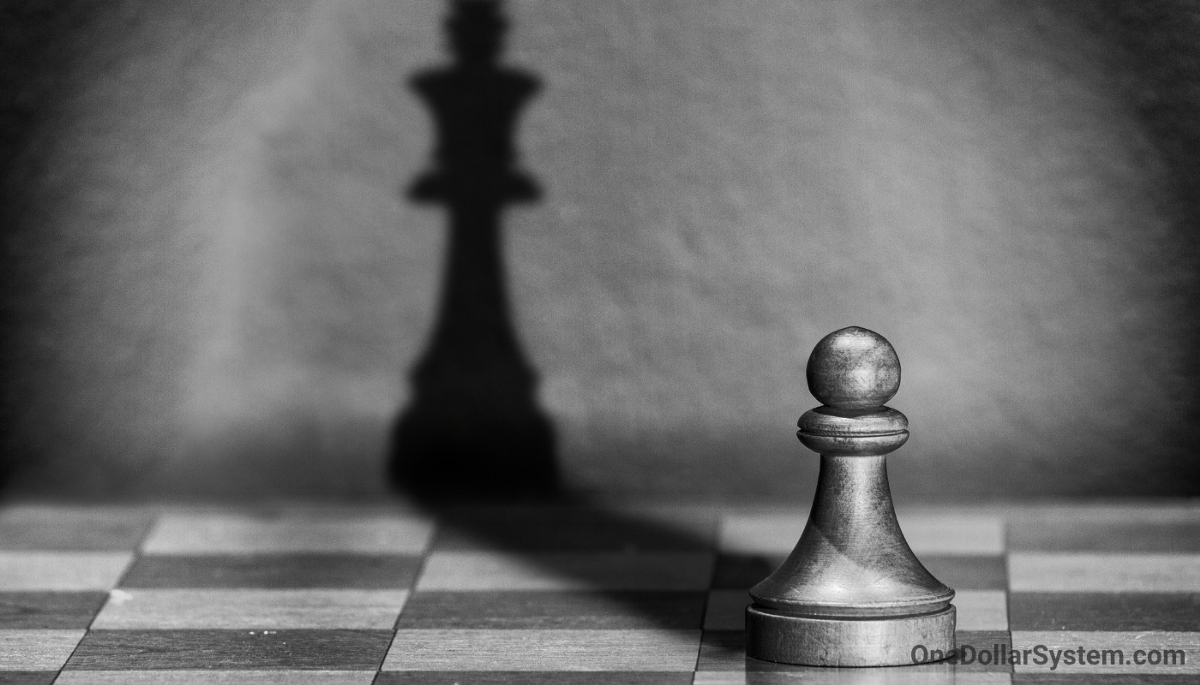 Build your authority. Black and white Chess pawn throwing a King's shadow.