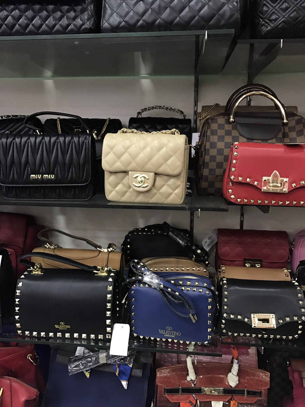 40aeaed2ea5 Counterfeit handbags in Indonesia. Photo by Becca Risa Luna. Counterfeit  Gucci, Balenciaga, Louis Vuitton ...