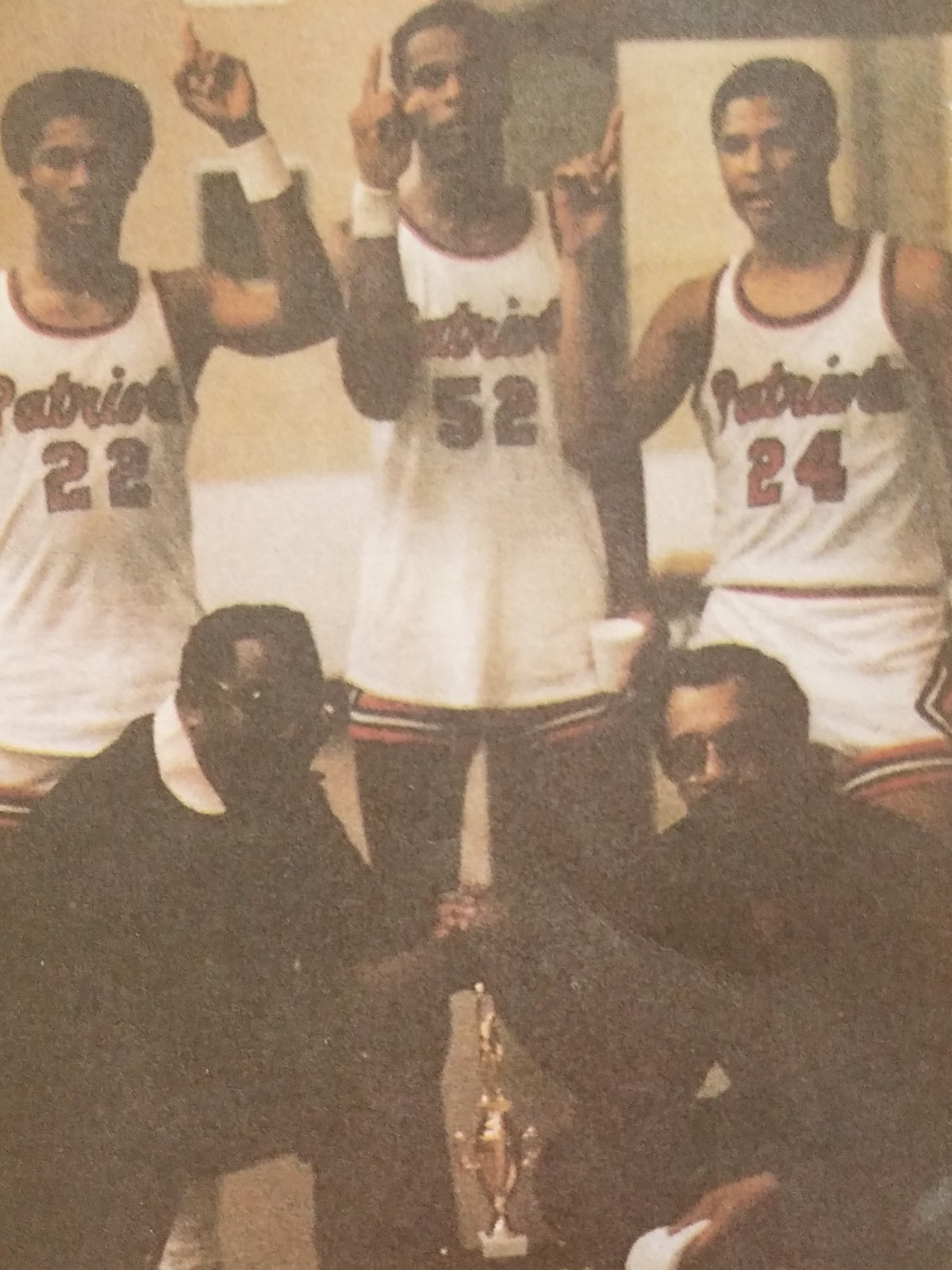 8cb791d909 The Big Three of Michael Hunt (#22), Terry Fair (#52) and Jeff Malone (#24)  lets everyone know who's number 1, while assistant coach Clyde Barden  (bottom ...