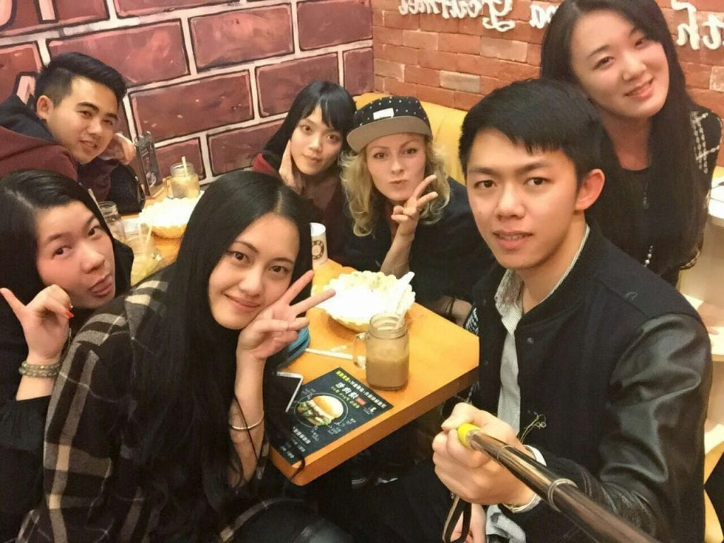 selfie of group of chinese people with foreigner
