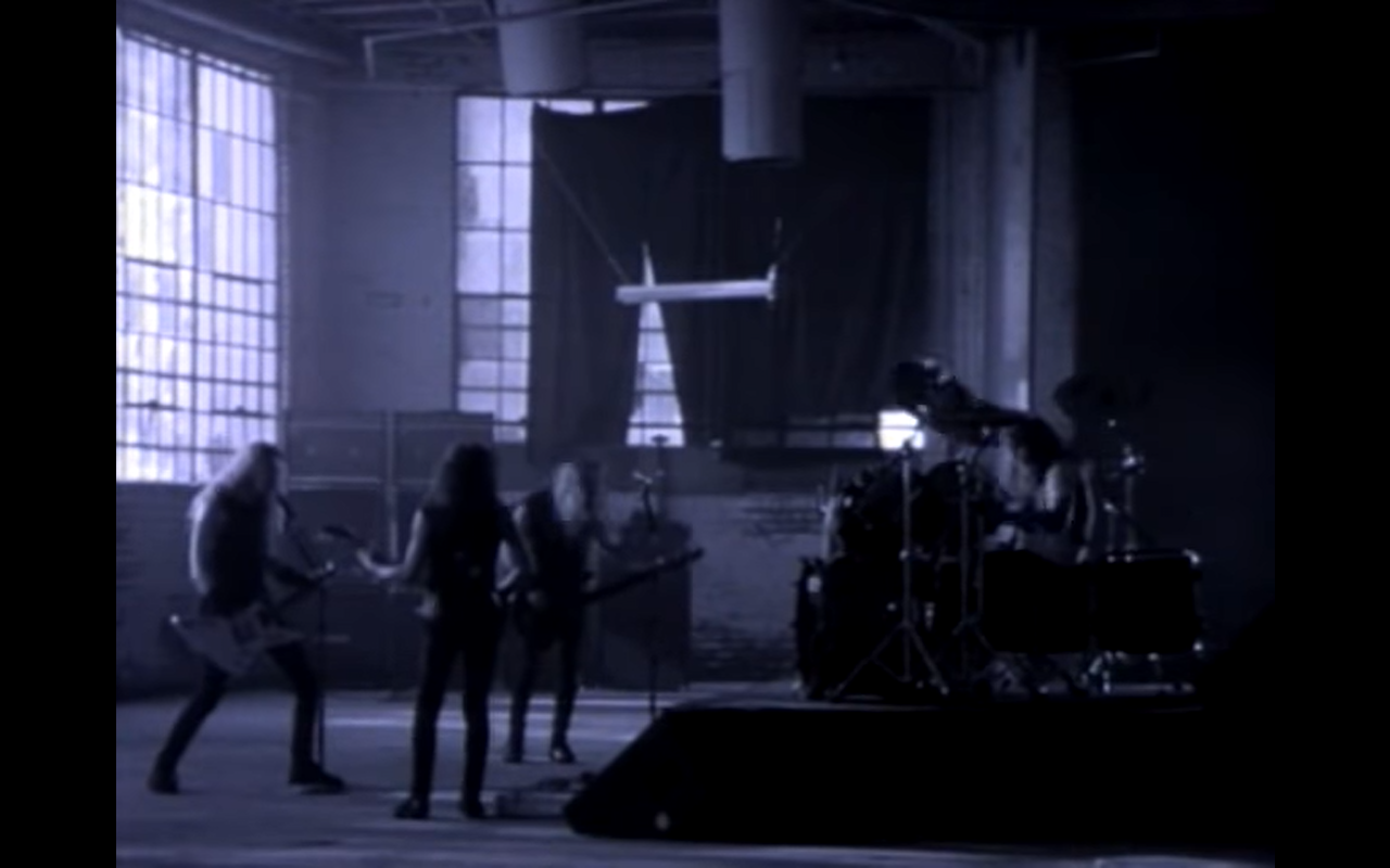 Fragment From The Music Video Of The Band Members Playing The Song In An Abandoned Building Metallica One