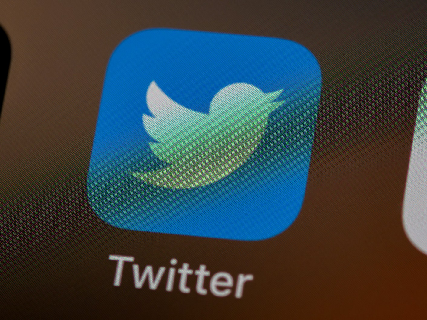 An image of the app 'Twitter' on a phone.