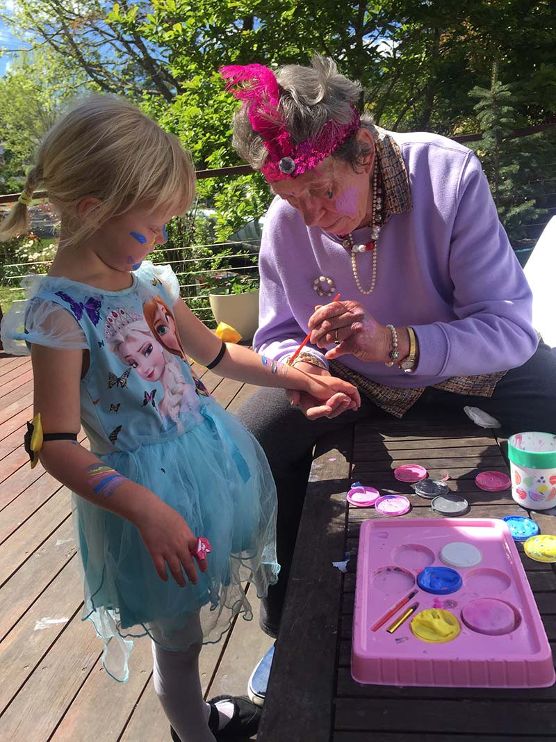 High Tea and arm painting with pink tiaras and pearls
