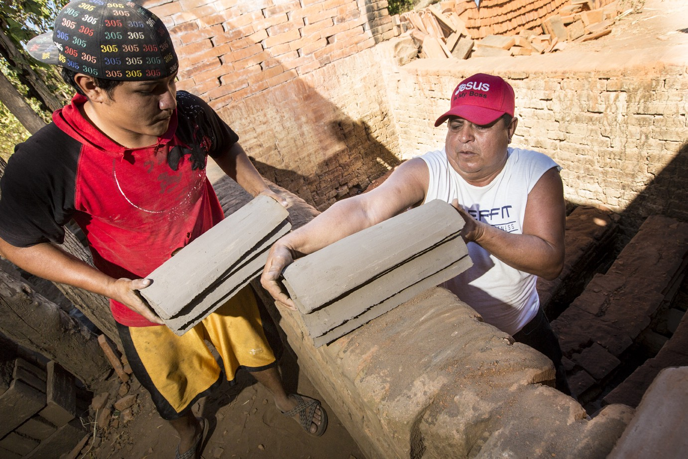 José Ramón Gómez builds his business with funding from Financiera FAMA in Nicaragua. These loans reinforce his tile-making enterprise so he can help reinforce his neighbor's roofs.