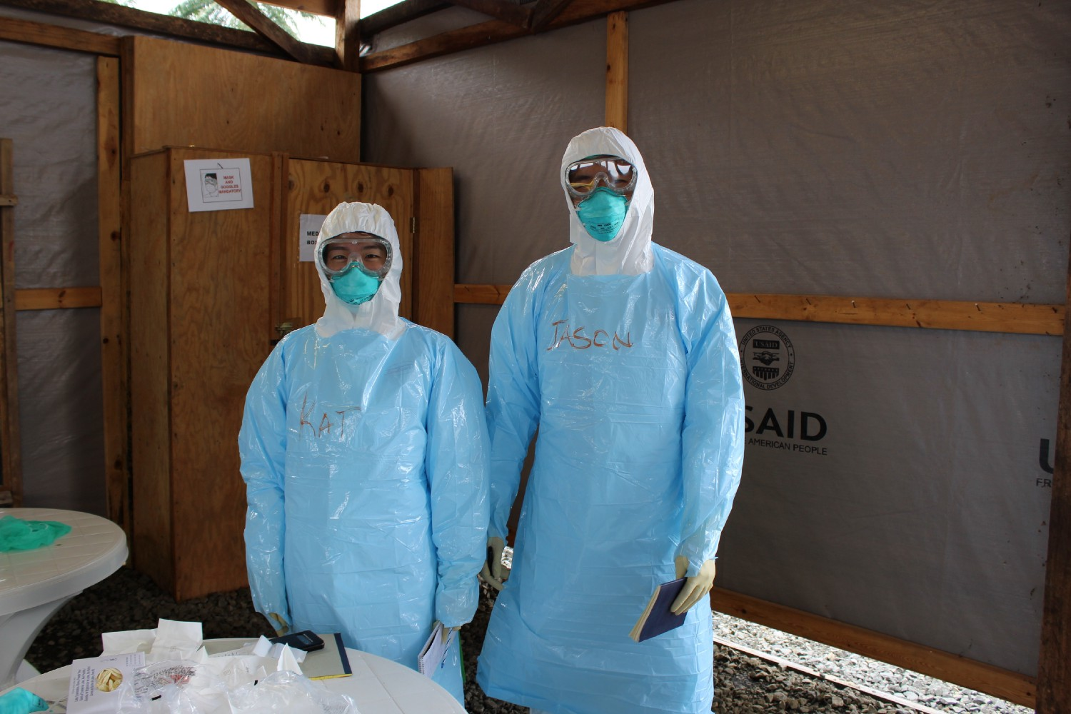 Katherine Jin and Jason Kang wear personal protective equipment at an Ebola Treatment Unit in Liberia. (Kevin Tyan)