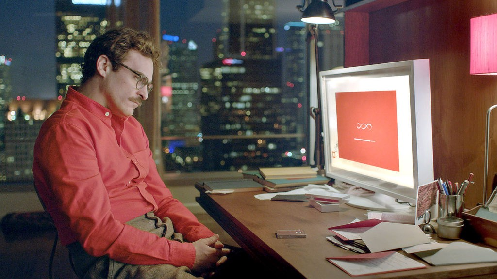 "JOAQUIN PHOENIX as Theodore in the romantic drama ""HER,"" directed by Spike Jonze, a Warner Bros. Pictures release."