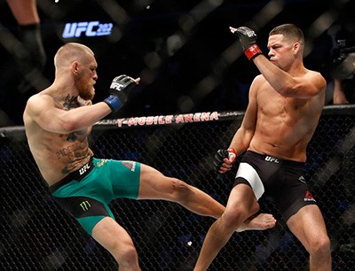 Conor Mcgregor successfully lands a leg kick on Nate Diaz at ufc 202.