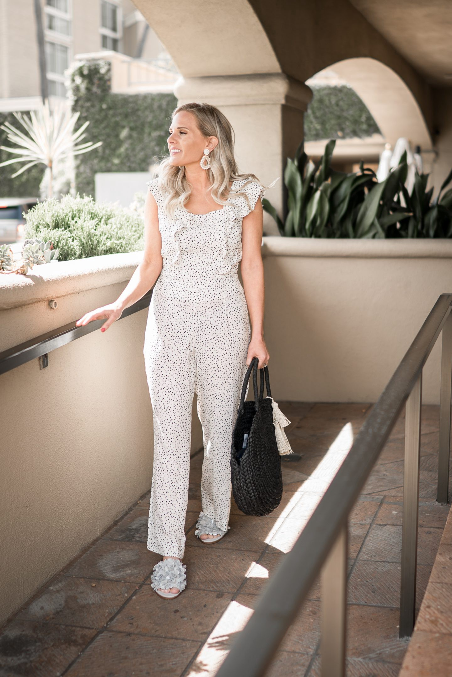 A Cute Ruffle Jumpsuit for Spring by popular Orange County fashion blogger Dress Me Blonde