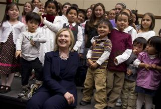 U.S. Secretary of State Hillary Rodham Clinton smiles as she greets the children of U.S. Embassy employees at the embassy in Tokyo Sunday, April 17, 2011. Clinton is on a brief visit to Tokyo intended as a morale boost to the crucial U.S. ally. (AP Photo/Saul Loeb, Pool)